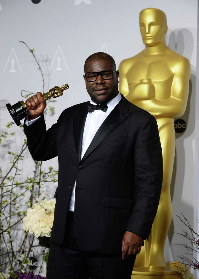 "Director Steve McQueen poses in the press room with the award for best picture for ""12 Years a Slave"" during the Oscars at the Dolby Theatre on Sunday, March 2, 2014, in Los Angeles.  (Photo by Jordan Strauss/Invision/AP) ORG XMIT: CACJ561 Photo: Jordan Strauss / Invision"