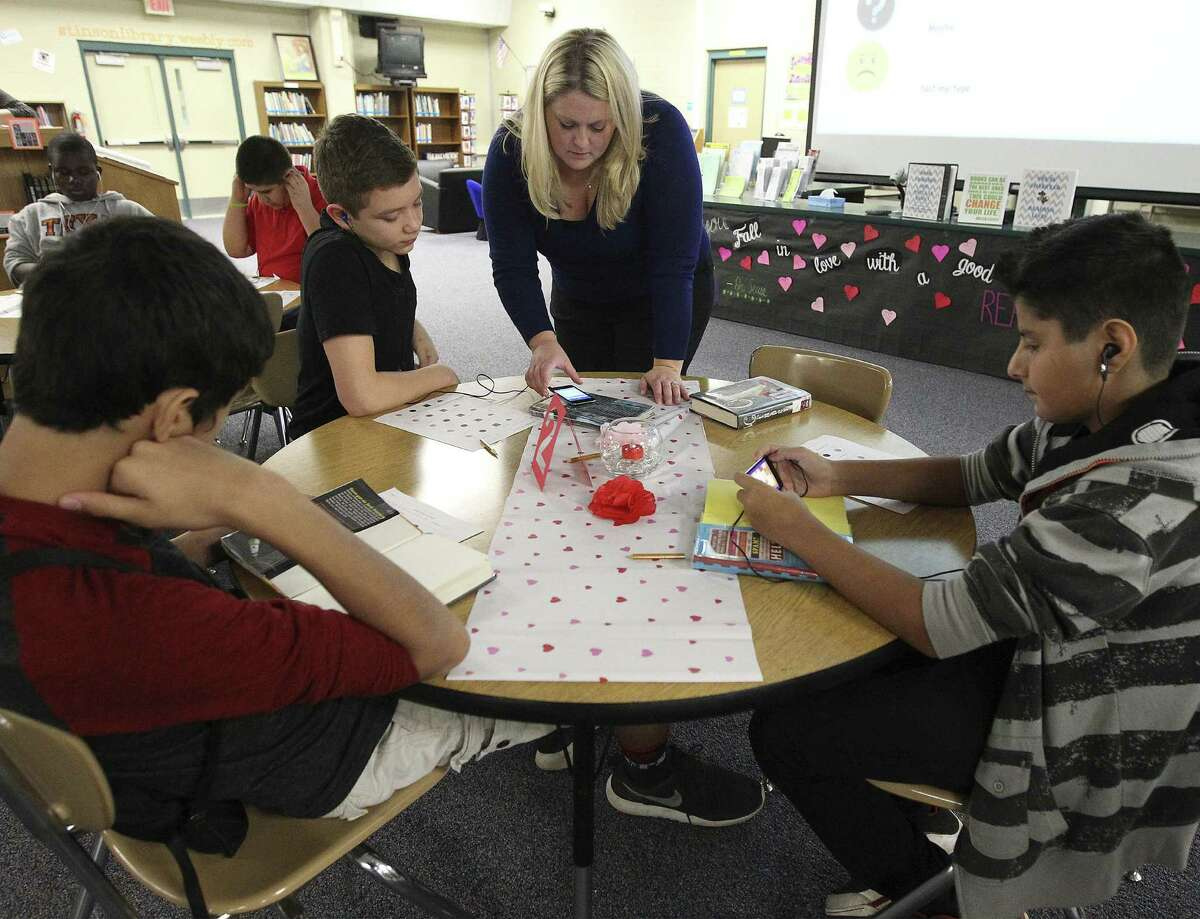 Stinson Middle School librarian Paige Fosmire created an activity for students called Book Speed Dating, in which students spend a few minutes reviewing books at various tables and then decide whether they wish to check them out.