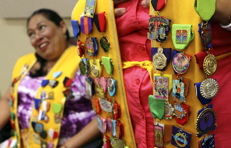 The San Antonio Express-News and MySanAntonio.com are looking for official and nonofficial Fiesta medals to compete in a Fiesta medal contest. Organizations, nonprofits, churches, fraternal groups, companies, individuals and others may enter. Photo: Express-News File Photo / SAN ANTONIO EXPRESS-NEWS