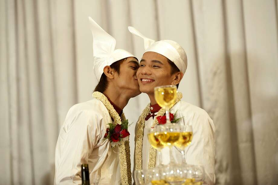 Trailblazers in Myanmar: Tin Ko Ko (right) and Myo Min Htet celebrate their nuptials at a 