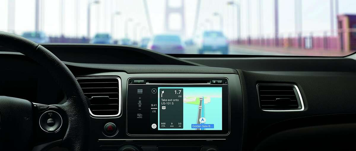 Apple's CarPlay, which lets iPhone users access their phone's functions through a car dashboard, will kick-off in Volvo, Mercedes-Benz and Ferrari and spread to others later, including BMW, Ford, General Motors, Honda, Hyundai, Jaguar Land Rover, Kia, Mitsubishi, Nissan, PSA Peugeot Citroën, Subaru, Suzuki and Toyota. This handout photo shows CarPlay being used in a Honda.