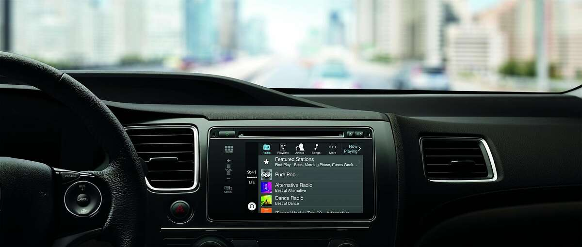 Apple's CarPlay lets iPhone users access their phone's functions using the buttons already installed in a car's dashboard.