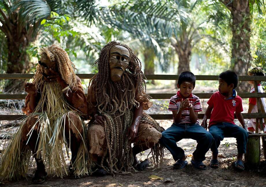 Hi, boys. Mind if we join you?Masked Mah Meri tribesmen take a load off after performing in the Hari Moyang festival in Pulau Carey, Malaysia. On Hari Moyang, or Spirit's Day, Mah Meri elders honor the spirits of their ancestors in the tribe's villages along the western coast of Malaysia. Photo: Manan Vatsyayana, AFP/Getty Images