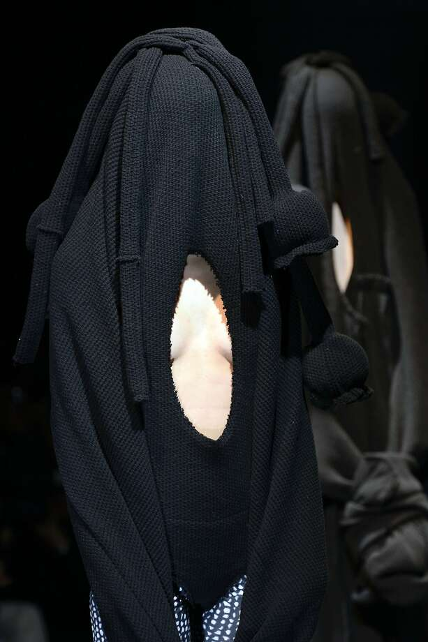 The latest fashion craze in Paris?Wearing your sweater like you can't find the hole for 