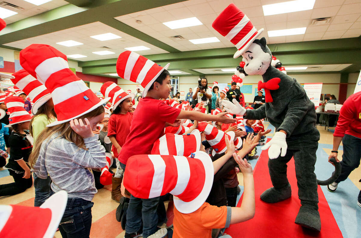 The Cat in the Hat greets students at Spicewood Park Elementary, 11303 Tilson, last week.