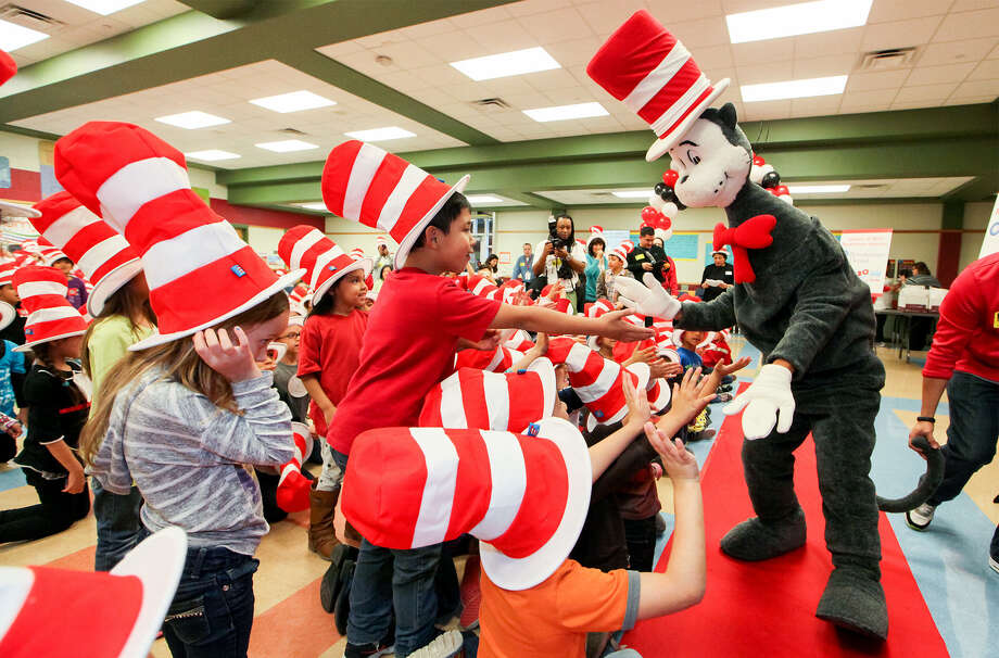 The Cat in the Hat greets students at Spicewood Park Elementary, 11303 Tilson, last week. Photo: Photos By Marvin Pfeiffer / Mpfeiffer@express-news.net / Express-News 2014