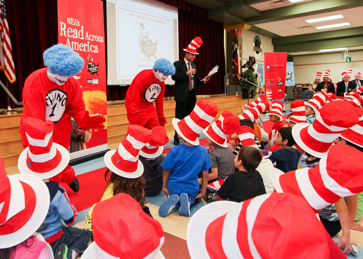 It's a sea of hats as Thing 1 and Thing 2 have fun with the students at Spicewood, one of two S.A. schools selected for