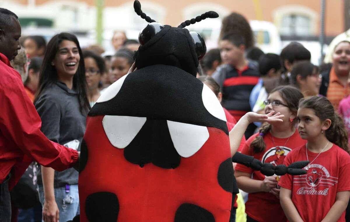 A larger- than-life ladybug (Beth Ferguson of OSU) enthralls the crowd.