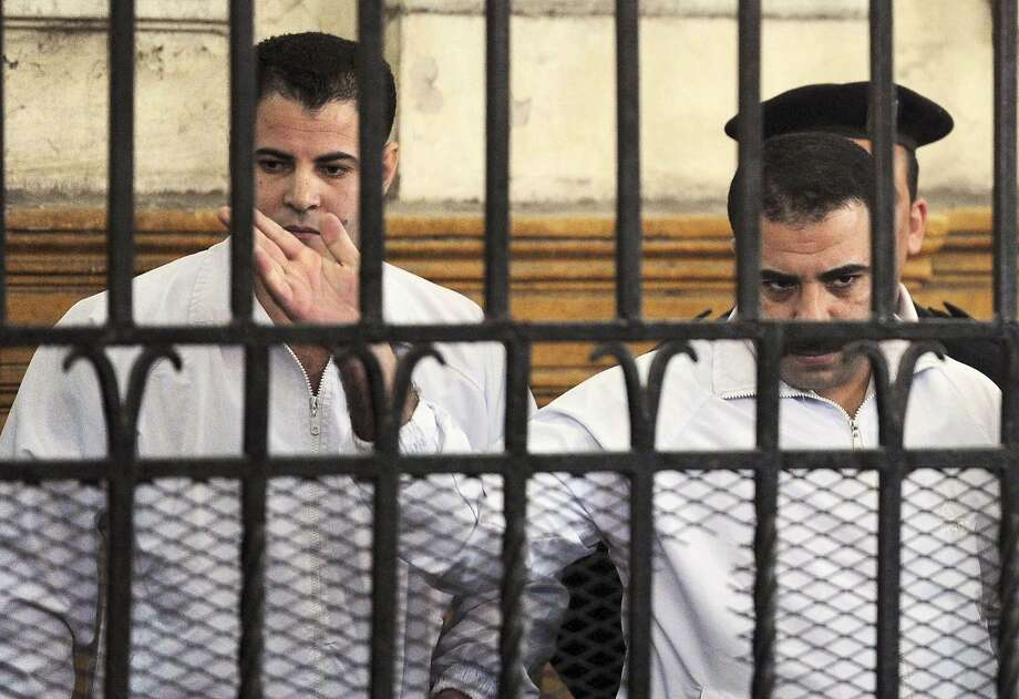 Police officers Mahmoud Salah (left) and Awad Suleiman beat Khaled Said to death in 2010. Photo: Stringer, Reuters
