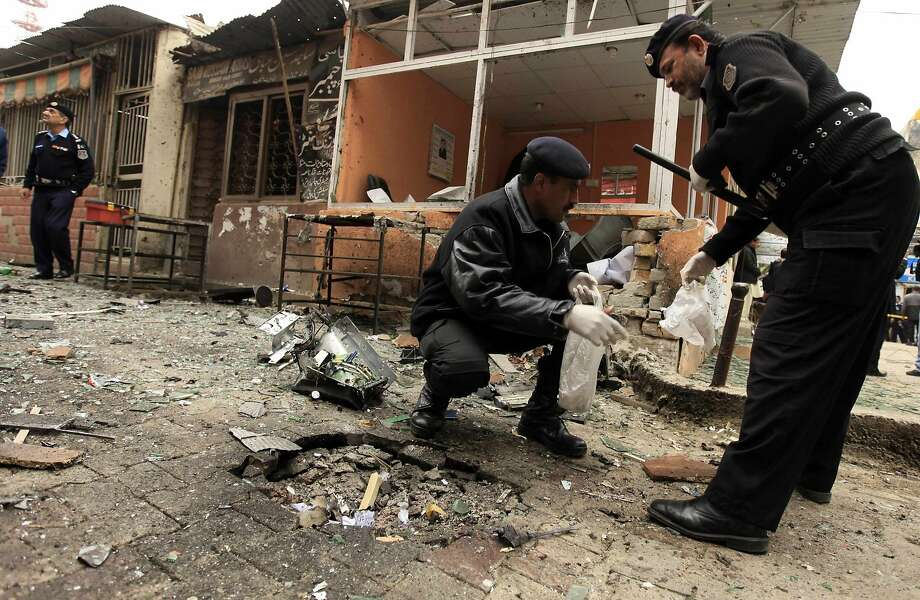 Police collect evidence after a bomb attack at the court complex in Pakistan's capital, Islamabad. Photo: Faisal Mahmood, Reuters