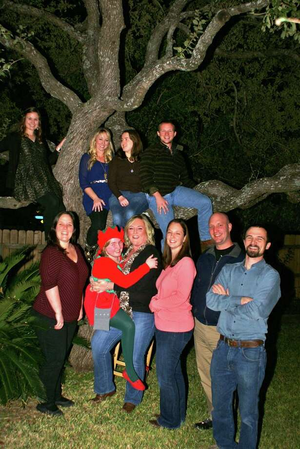 Then: The original photo was taken in our grandma's backyard in 2000. In the tree (L to R): Jeni Quante, Ashlee Davison, Emily Beissner, Alex Quante; standing (L to R): Whitney Beissner, Kelly Beissner, Calee Beissner, Sondra Walker, Brad Beissner, Nick Quante Photo: Courtesy