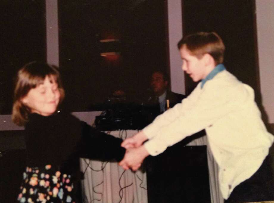 Emma Davis (5) and her cousin Brandon Praeger (8) in January of 1997 at Holy Spirit Catholic Church for the marriage of Melinda and Steve Nevels. Photo: Courtesy