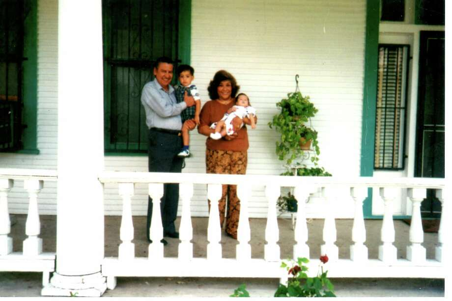 Then:  In November 1994, Grandparents Oscar Rios Sr., then 54 years old and Amelia Rios, then 56 years old, pose for a Thanksgiving Day photo at 306 South Carolina Street with their grandsons John Rios on left at two years old and Oscar Rios III on right at eight months old. Photo: Courtesy