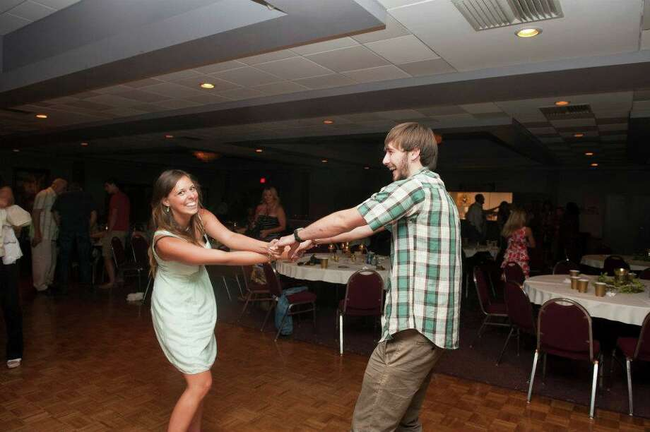 The newer picture, was taken in July of 2012 at an anniversary party of Buddy and Evie Magee (Melinda's parents) on the exact same dance floor at Holy Spirit. Photo: Courtesy