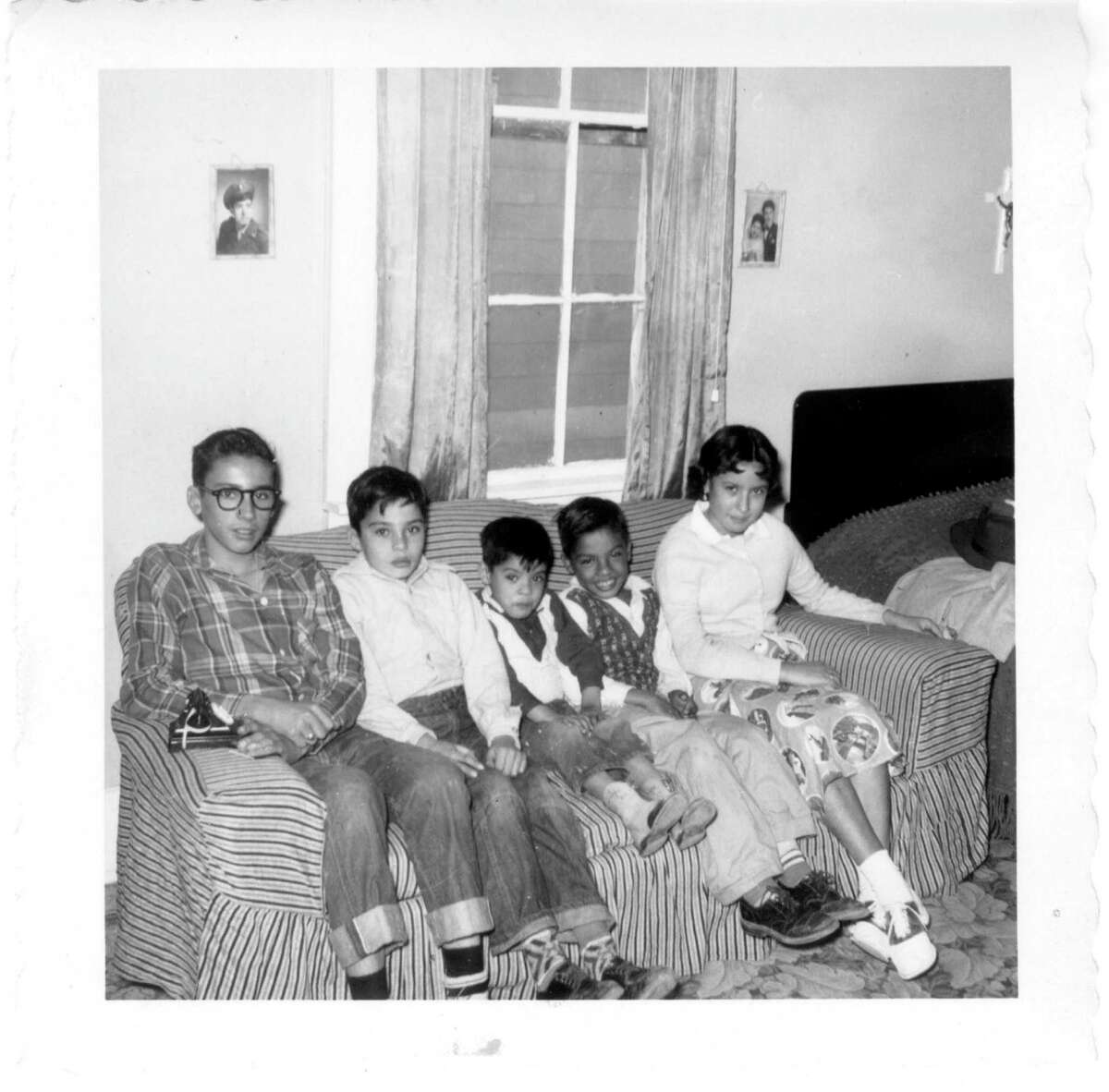 Then: In 1953, the Carter children took this photo in their grandparents' Eagle Pass home. They are (from left): William(12), Mario(8), Edward(3), Robert(6), and Irma Carter(10).