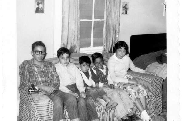 Then: B&W picture taken CA 1953 at the grandparents Daniel house in Eagle Pass, TX, seated left to right, William(12), Mario(8), Edward(3), Robert(6), and Irma Carter(10).