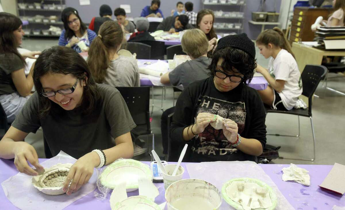 Gabriela Rodriguez (left) and Miranda Gutierrez, both 13, try their hands at sculpting. A nonprofit, SAY Sí helps students develop artistic and social skills.