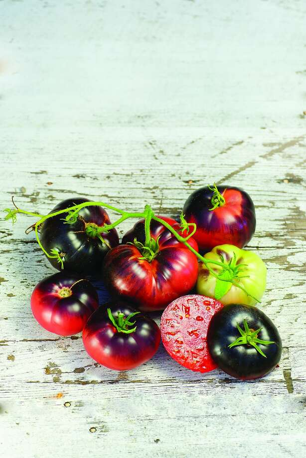 'Blue Beauty' tomatoes owe their skin color to anthocyanins, also present in blueberries. The flesh is red. Photo: Baker Creek Seed Co.