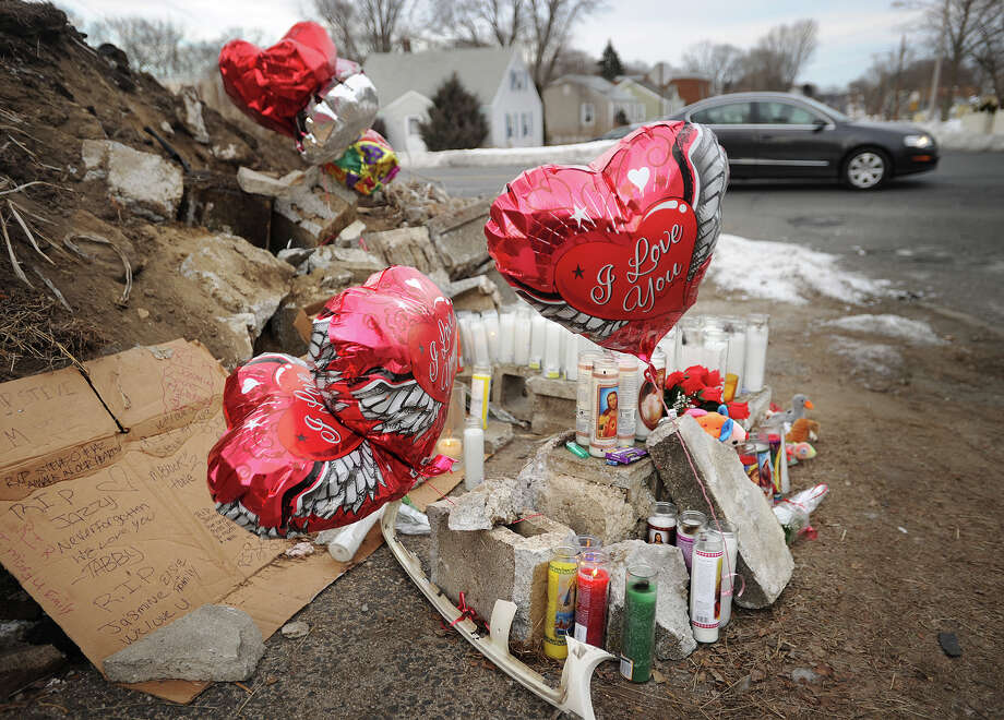 A memorial has grown at the base of a demolished retaining wall, the site of Saturday's fatal automobile crash at the corner of Queen Street and Madison Avenue in Bridgeport, Conn. on Monday, March 3, 2014. Killed in the crash were Steven Mountjoy, 35, and Yasmin Pedroza, 22, both of Bridgeport. Photo: Brian A. Pounds / Connecticut Post