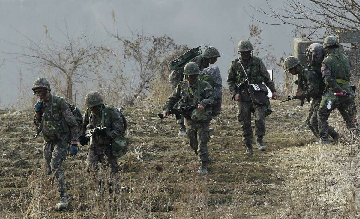 Soldiers move during a military exercise in Paju, South Korea, near the border with North Korea on Friday. Defense Secretary Chuck Hagel unveiled a budget that will reduce the  Army to pre-World War II levels.