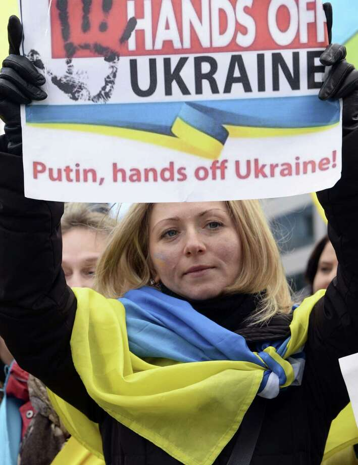 An anti-war demonstrator in Brussels takes part in a protest against Russian intervention in Ukraine. It's pointless to pretend there's a way to make Vladimir Putin surrender Crimea if he wants to keep it. Photo: Thierry Charlier / AFP / Getty Images / AFP