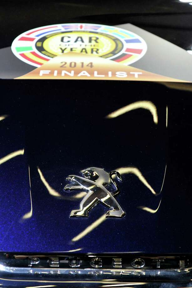 """The Peugeot 308 is awarded """"Car of the Year 2014"""" during the opening day of the 84th International Motor Show which will showcase novelties of the car industry on March 3, 2014 in Geneva, Switzerland. Photo: Harold Cunningham, Getty Images / 2014 Getty Images"""