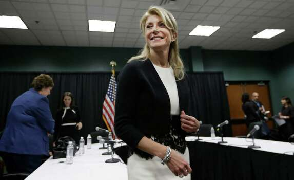 FILE - In this Jan. 9, 2014 file photo, Texas Sen. Wendy Davis smiles as she heads to speak to reporters after an education roundtable meeting in Arlington, Texas. Davis is expected to face Republican Greg Abbott in the Texas governor's race. Battleground Texas, a major Democratic effort aimed at turning one of the reddest states blue, will face its first test in the Democratic primary on March 4. Photo: LM Otero, AP / AP