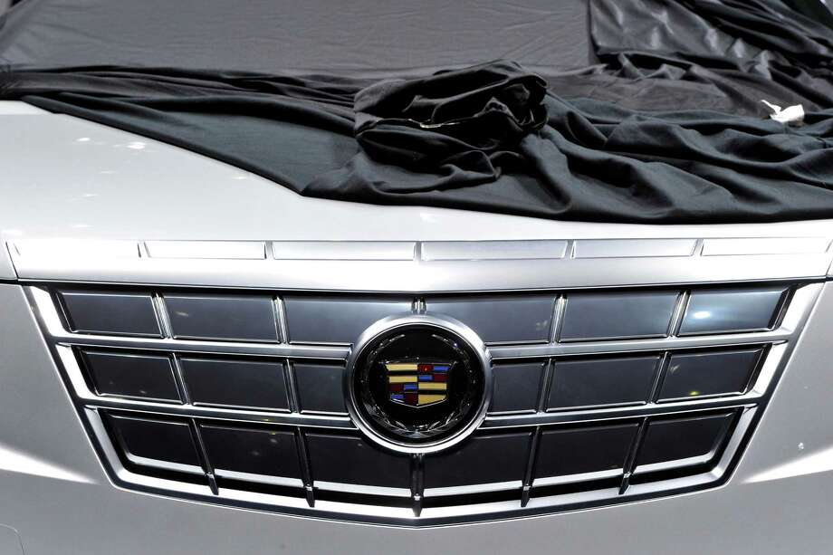 A Cadillac is prepared ahead of the opening day of the 84th International Motor Show which will showcase novelties of the car industry on March 3, 2014 in Geneva, Switzerland. Photo: Harold Cunningham, Getty Images / 2014 Getty Images