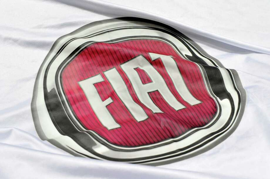 A Fiat is prepared ahead of the opening day of the 84th International Motor Show which will showcase novelties of the car industry on March 3, 2014 in Geneva, Switzerland. Photo: Harold Cunningham, Getty Images / 2014 Getty Images