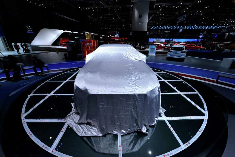 A Ford Mustang is prepared ahead of the opening day of the 84th International Motor Show which will showcase novelties of the car industry on March 3, 2014 in Geneva, Switzerland. Photo: Harold Cunningham, Getty Images / 2014 Getty Images
