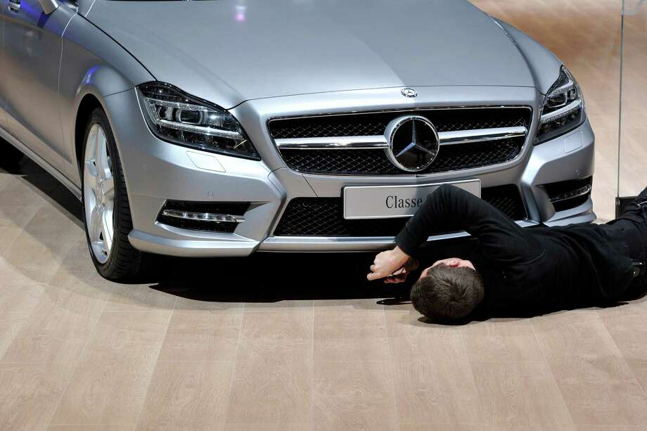 A Mercedes-Benz is prepared ahead of the opening day of the 84th International Motor Show which will showcase novelties of the car industry on March 3, 2014 in Geneva, Switzerland. Photo: Harold Cunningham, Getty Images / 2014 Getty Images