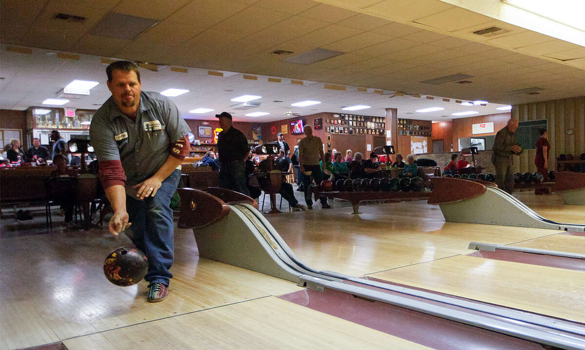 George Franken bowls in 9-pin bowling league play at the Bracken Bowling Club.