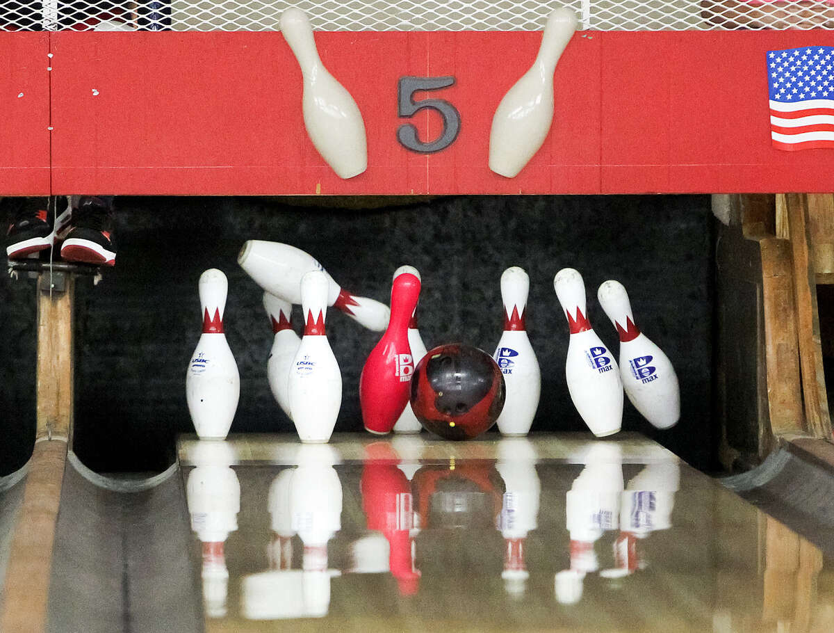 Pins fly during a 9-pin bowling league game at the Cibolo Bowling Center, 601 N. Main St. Nine-pin play has been popular for generations and still draws crowds in Central and South Texas.