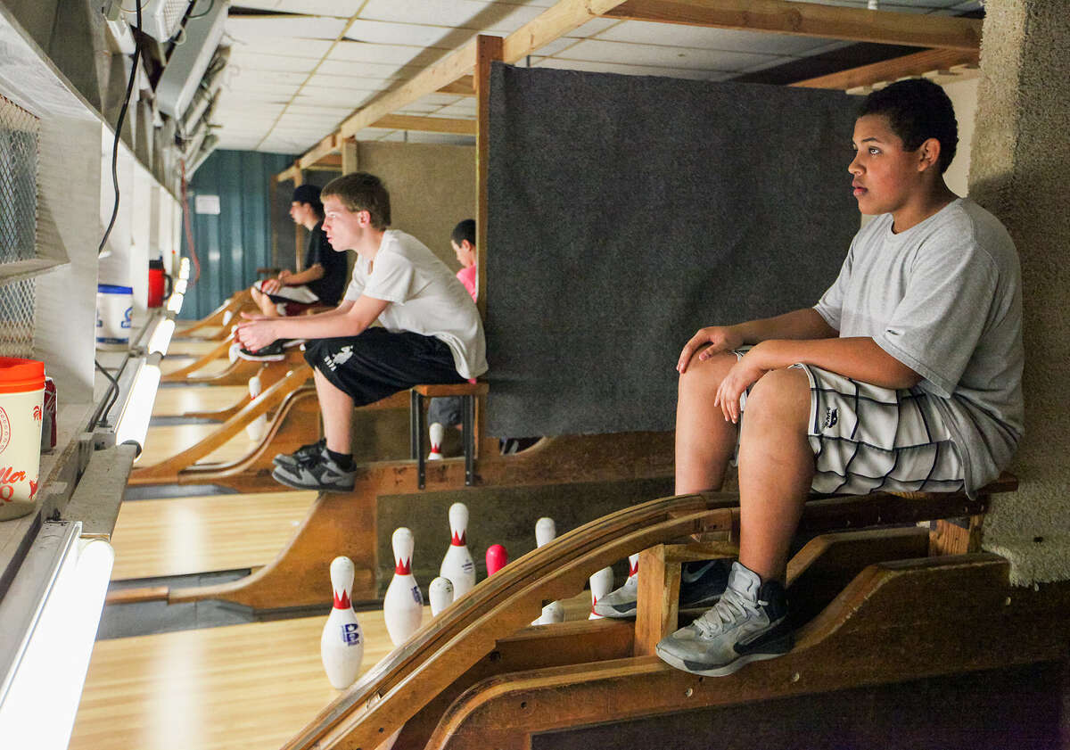 Malcolm Greenwood, right, and Andrew Johnson wait to set pins.