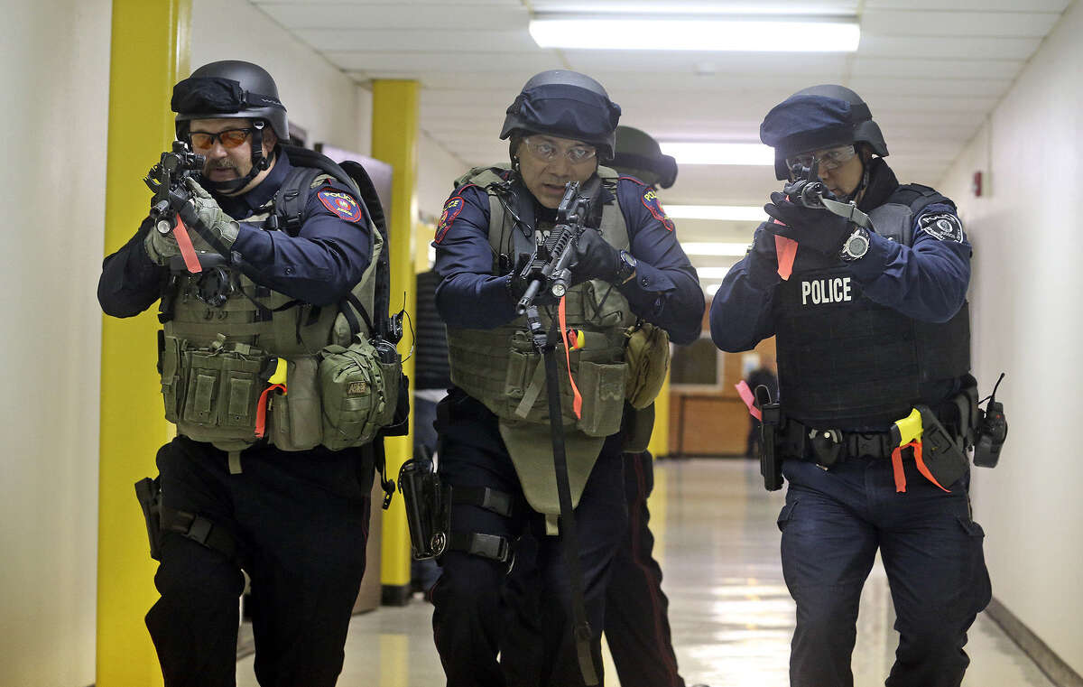 Team members prepare to check out a classroom as the Judson ISD Emergency Response team practices with a drill at the Judson Education Community Center on Feb. 6.