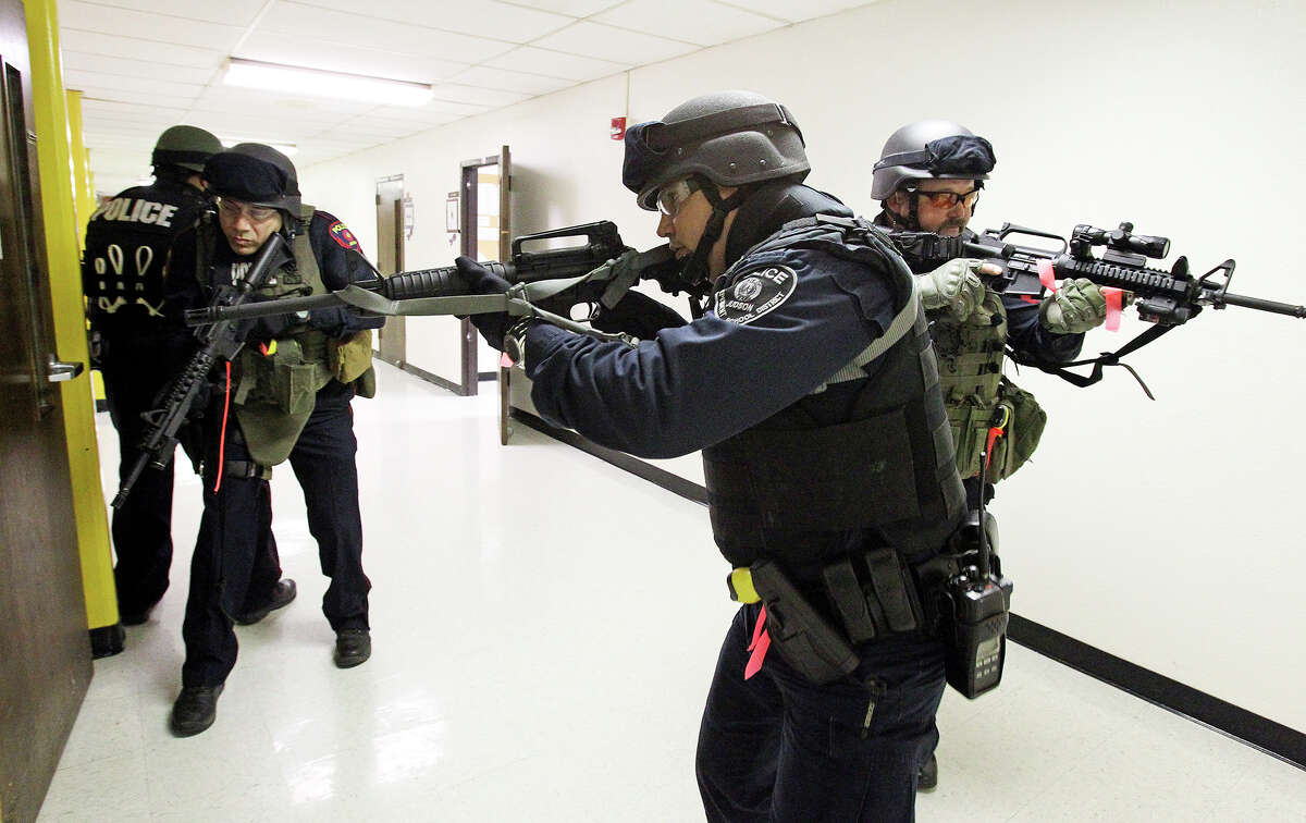 Team members prepare to check out a classroom as the Judson ISD Emergency Response team practices with a drill at the Judson Education Community Center on February 6, 2014.
