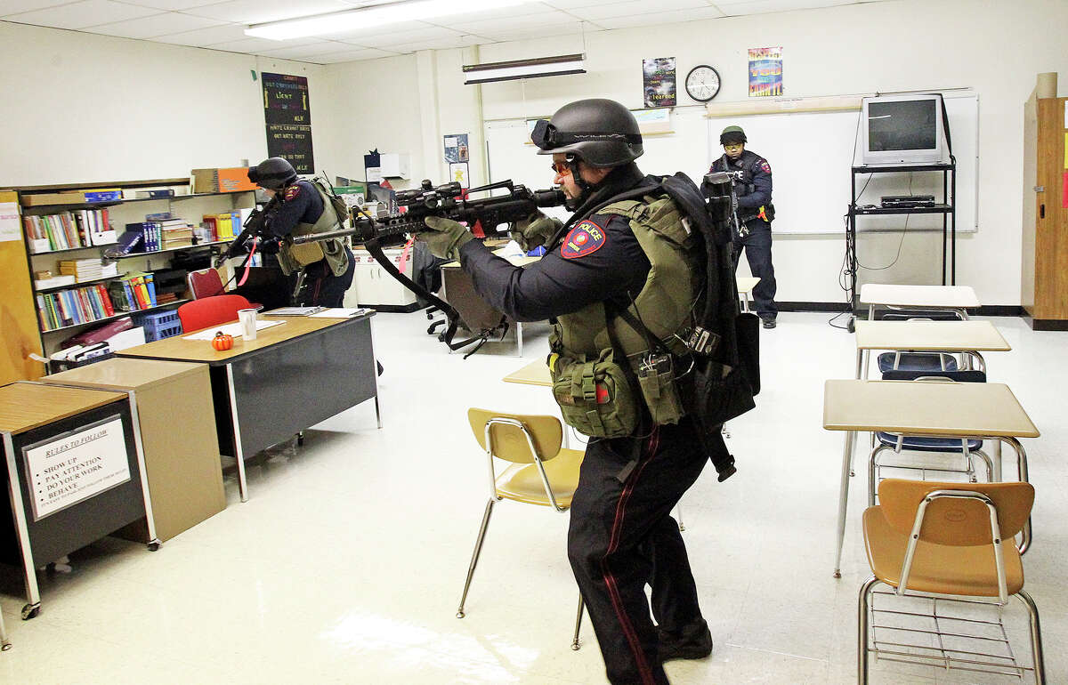 Team members check out a classroom as the Judson ISD Emergency Response team practices with a drill at the Judson Education Community Center on February 6, 2014.