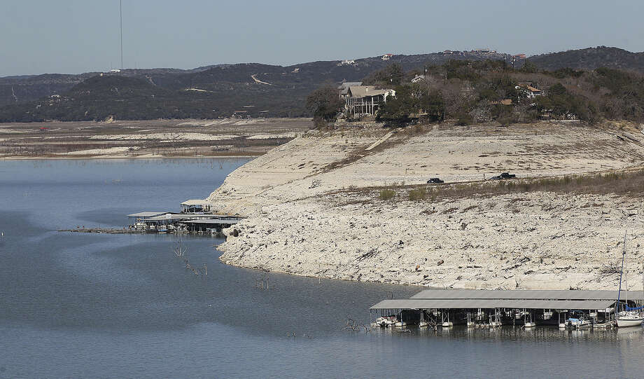 The dropping level of Medina Lake is marked by exposed land in this view from Medina Dam Feb. 4. Photo: San Antonio Express-News / ©2013 San Antonio Express-News