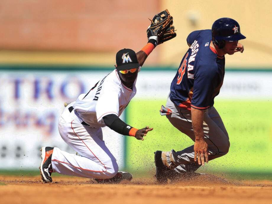 Robbie Grossman is caught stealing at second base by Miami's Adeiny Hechavarria. Photo: Karen Warren, Houston Chronicle