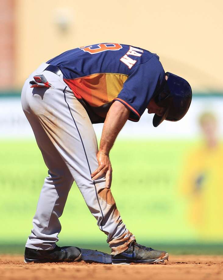 Robbie Grossman reacts after he was caught stealing second base by Miami's Adeiny Hechavarria. Photo: Karen Warren, Houston Chronicle