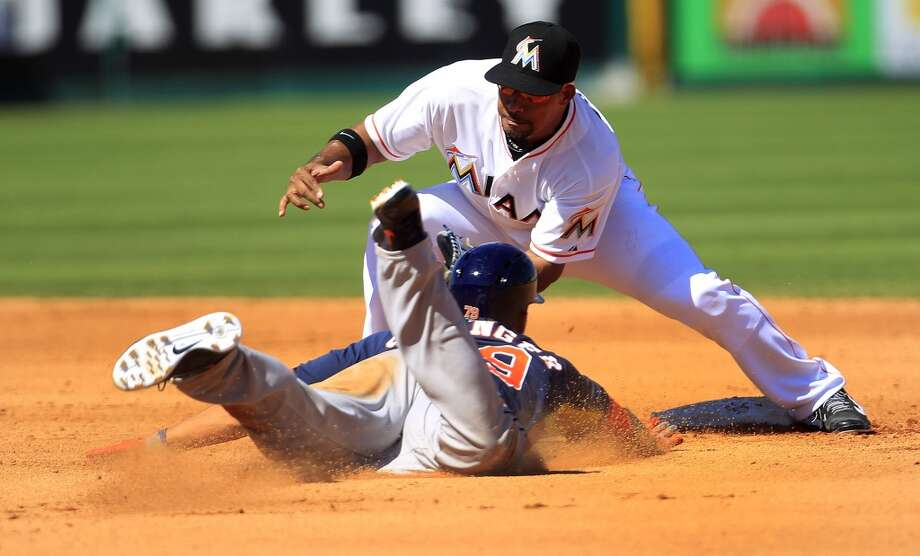 Miami's Rafael Furcal tags out George Springer at second base in the fourth inning. Photo: Karen Warren, Houston Chronicle