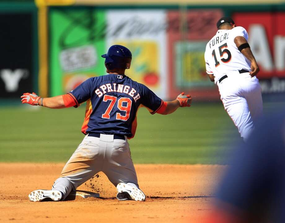 George Springer reacts after being tagged out at second by Miami's Rafael Furcal in the fourth inning. Photo: Karen Warren, Houston Chronicle