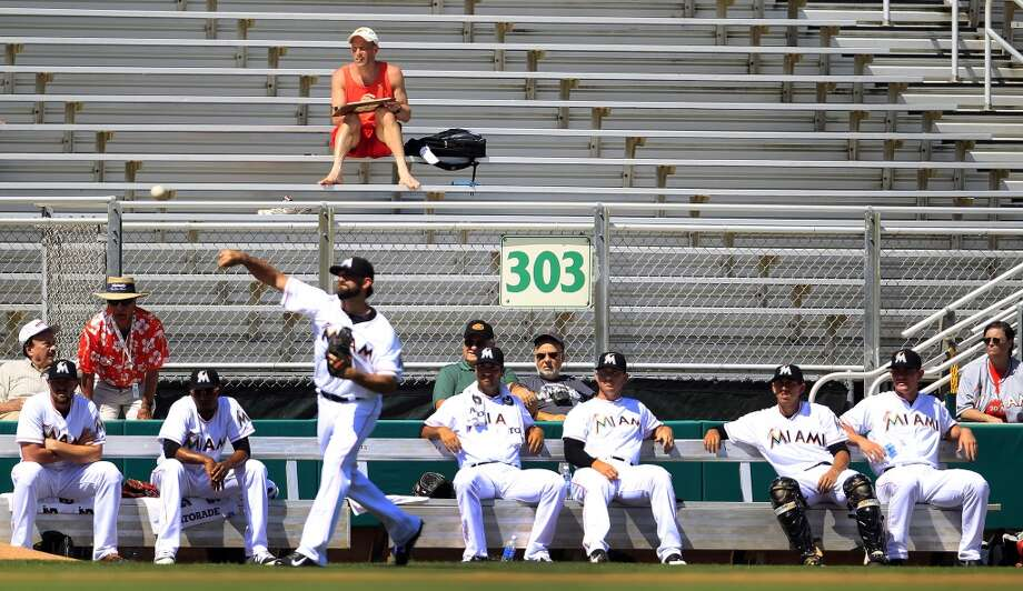A few fans sit above the Miami Marlins bullpen in the second inning. Photo: Karen Warren, Houston Chronicle