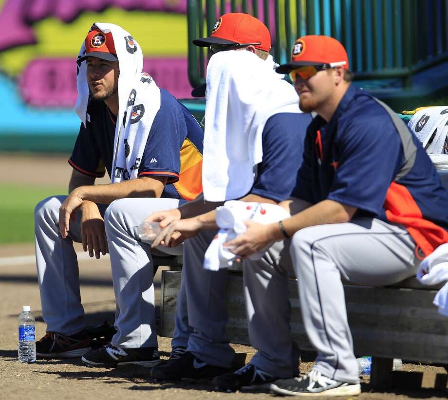 Members of the Astros bullpen try to stay cool with hot temps in the 80s. Photo: Karen Warren, Houston Chronicle