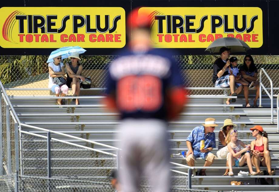 A handful of fans sit in the outfield bleachers as Dallas Keuchel pitches in the second inning. Photo: Karen Warren, Houston Chronicle