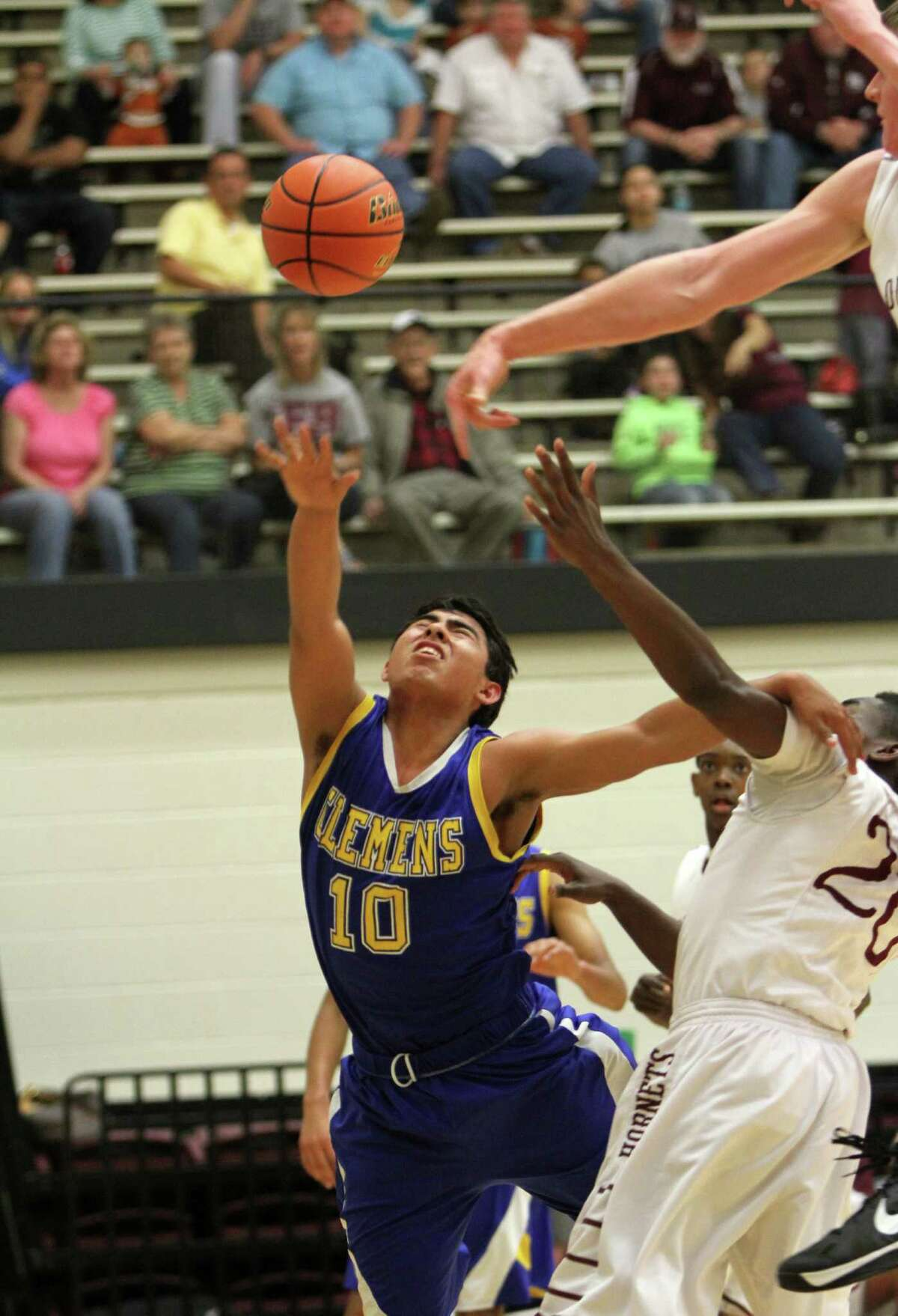 Clemens' Ernesto Castillo (10) is fouled during a win Friday over Corpus Christi Flour Bluff.