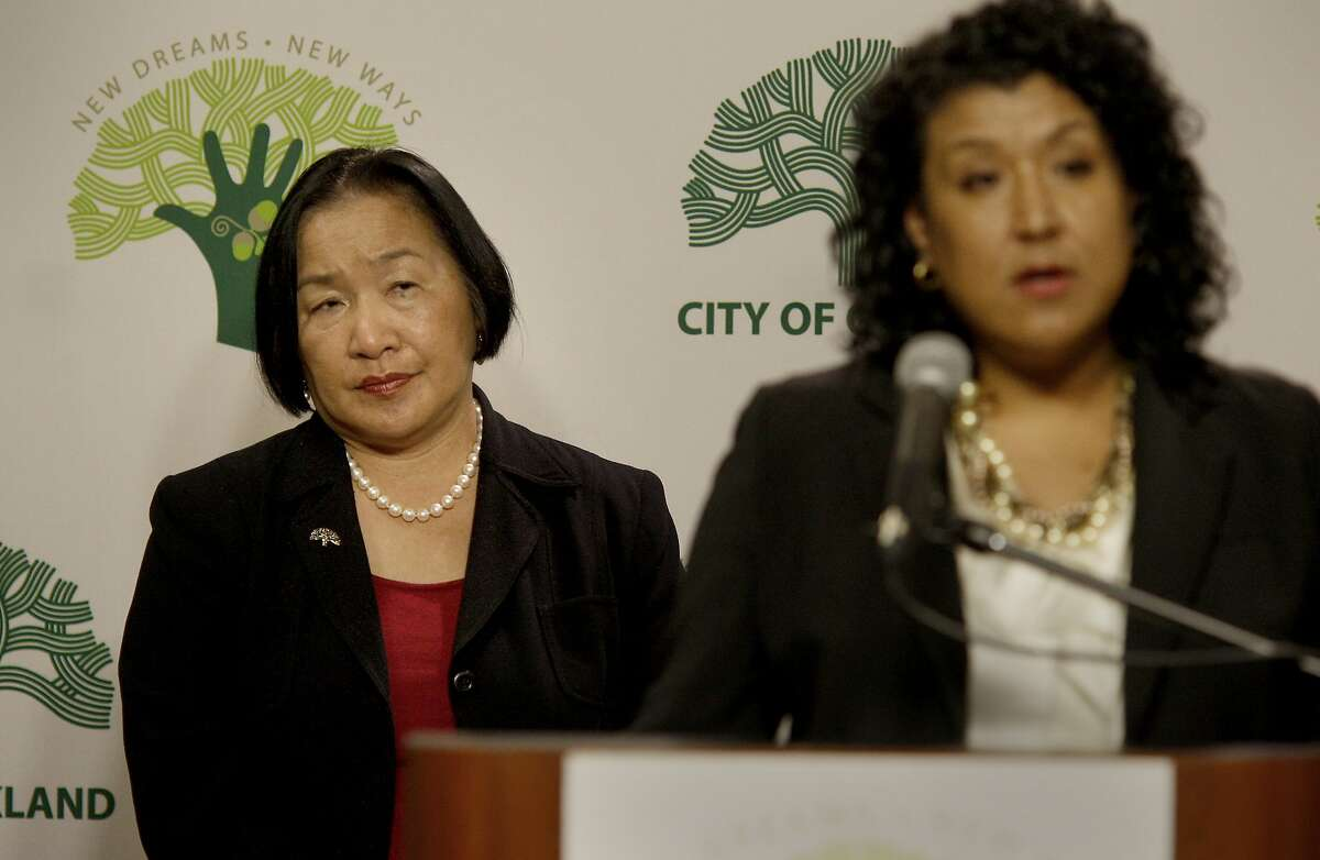 Mayor Quan (left) listened as City Administrator Deanna J. Santana explained the numbers. Oakland officials including Mayor Jean Quan presented an amended policy budget to balance the city budget following the loss of Redevelopment funding Monday January 23, 2012.