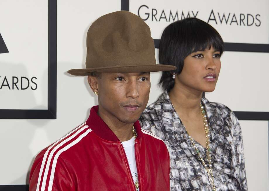 Recording artist Pharrell Williams (L) and Helen Lasichanh arrive on the red carpet for the 56th Grammy Awards at the Staples Center in Los Angeles on January 26, 2014.    AFP PHOTO/ROBYN BECK        (Photo credit should read ROBYN BECK/AFP/Getty Images) Photo: ROBYN BECK, AFP/Getty Images