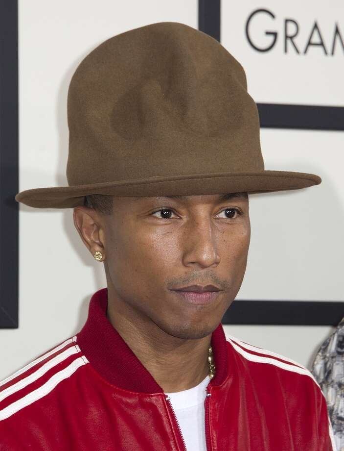 Recording artist Pharrell Williams arrives on the red carpet for the 56th Grammy Awards at the Staples Center in Los Angeles on January 26, 2014.   AFP PHOTO/ROBYN BECK        (Photo credit should read ROBYN BECK/AFP/Getty Images) Photo: ROBYN BECK, AFP/Getty Images