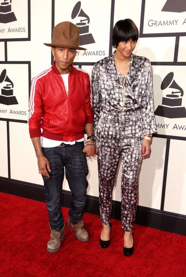 LOS ANGELES, CA - JANUARY 26: Recording artist Pharrell Williams (L) and Helen Lasichanh attend the 56th GRAMMY Awards at Staples Center on January 26, 2014 in Los Angeles, California.  (Photo by Jeff Vespa/WireImage) Photo: Jeff Vespa, WireImage